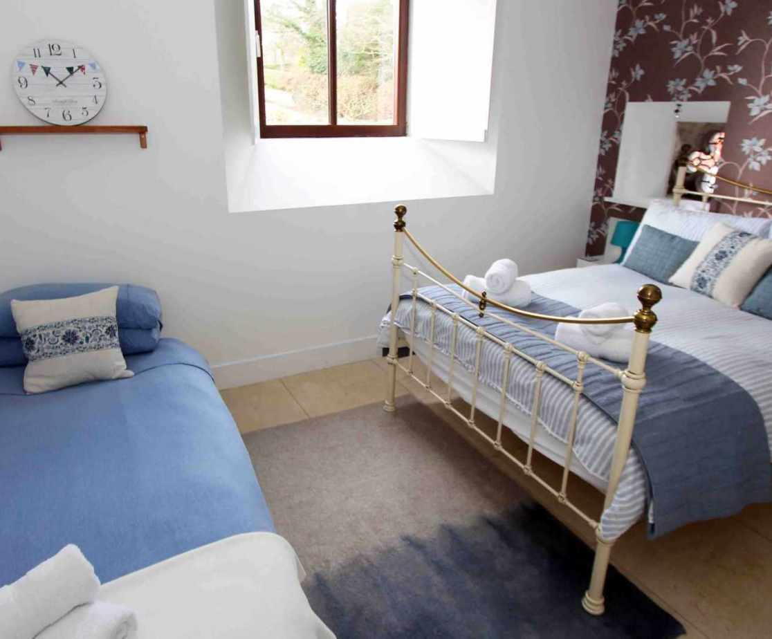 Bedroom 4, a stylish double room with additional day bed suitable for children