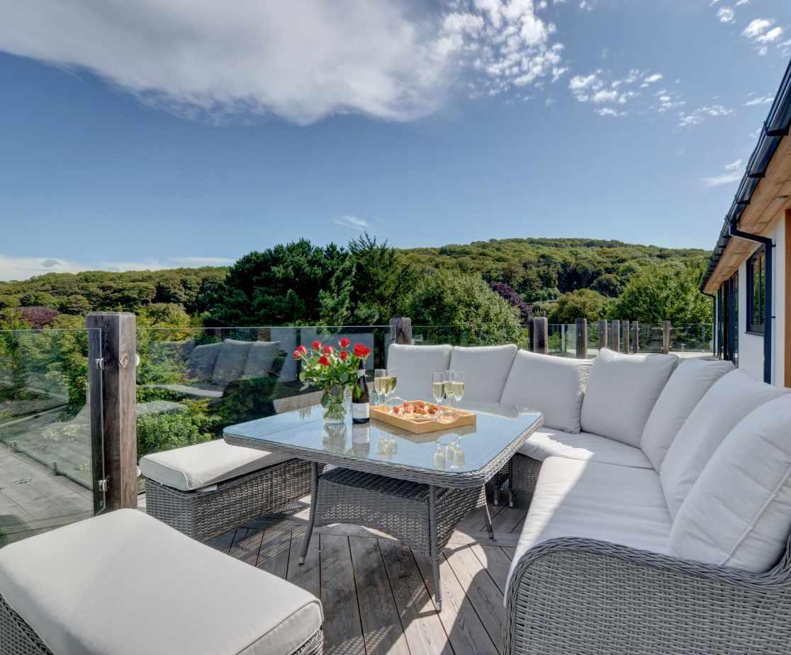 Beautifully comfortable rattan garden furniture on the top terrace