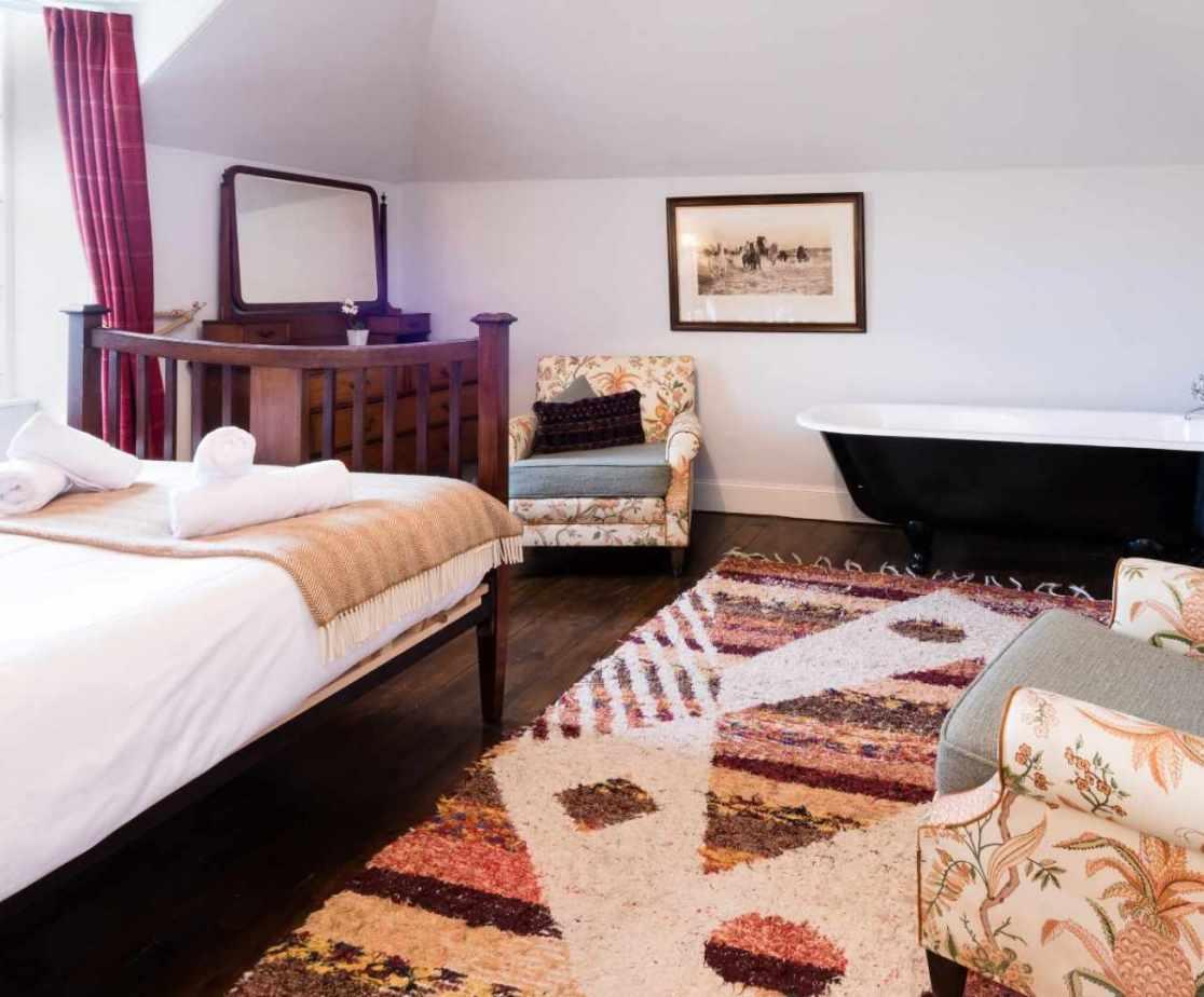 Freestanding bath in one of the bedrooms