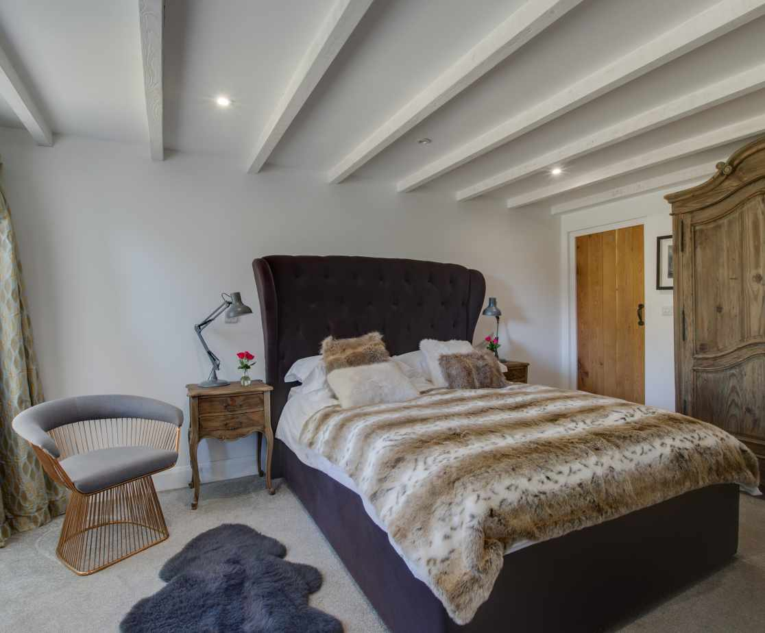 Ground floor bedroom with a king size bed and en suite shower room