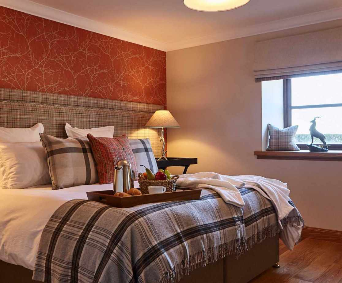 Room 2 is a super king size zip-and-link double bed on the ground floor