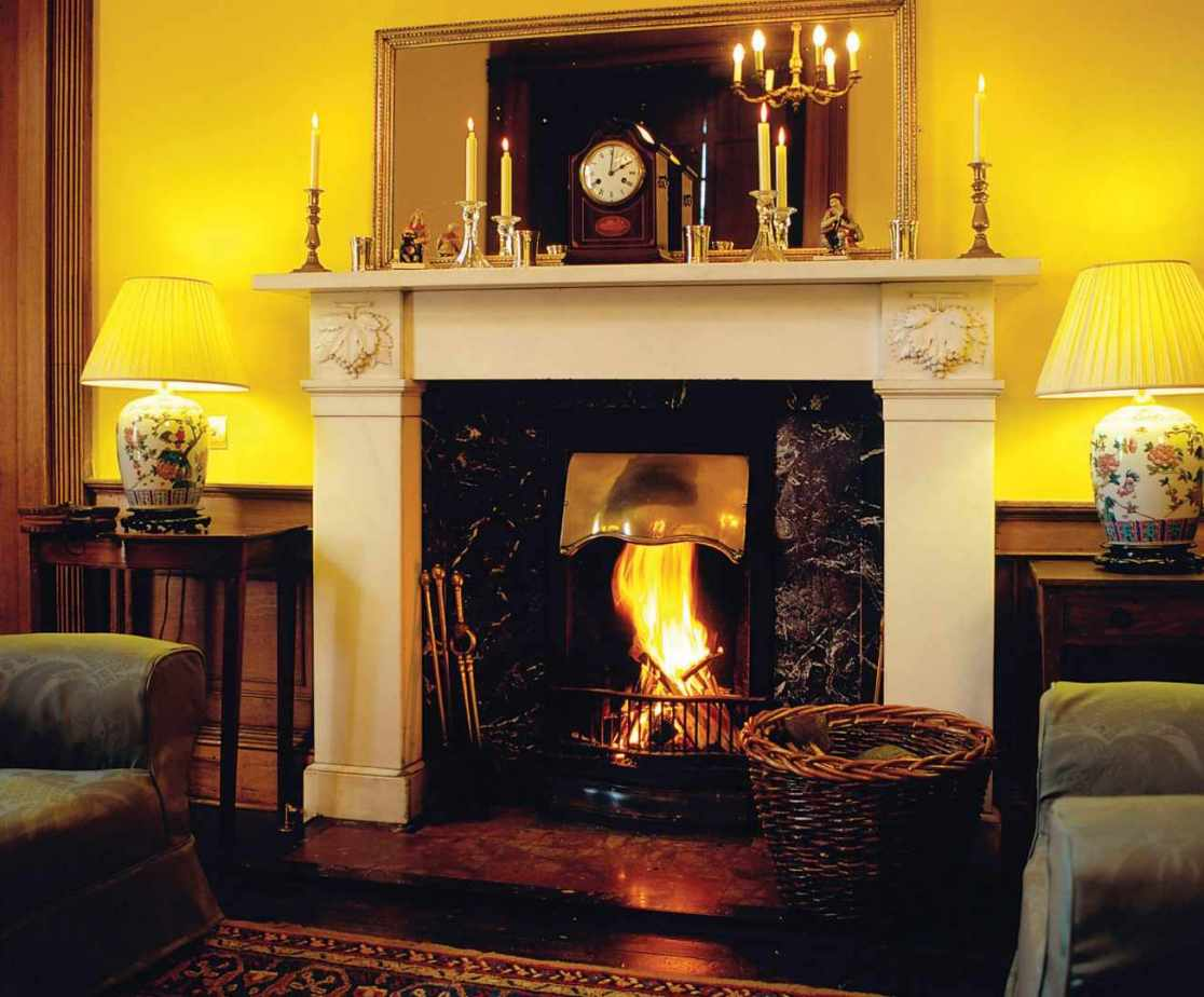 Enjoy a glass of your chosen tipple in front of the cosy open fire in the drawing room