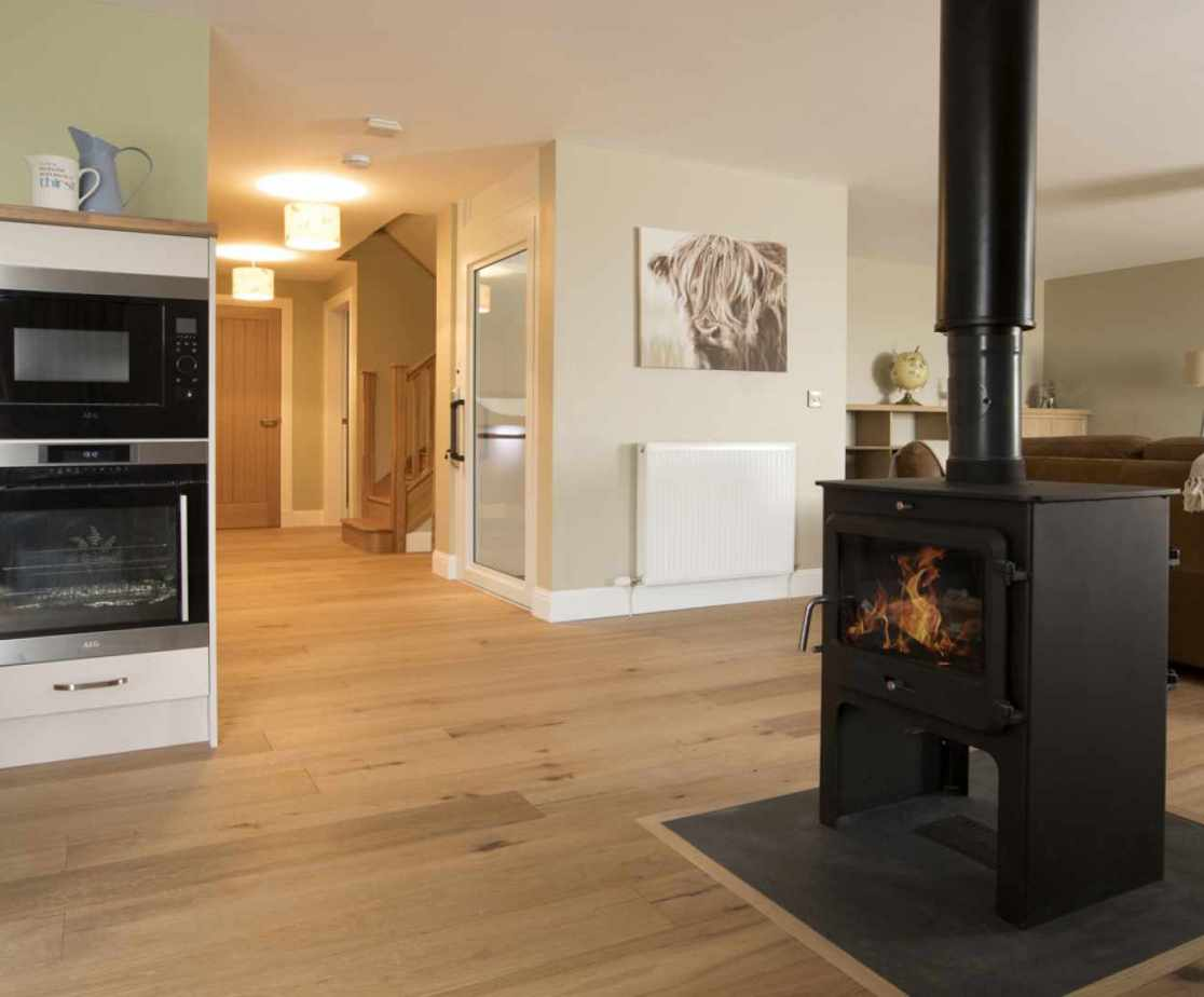 Luxury Perthshire Farmhouse, open plan kitchen, sitting and dining with double sided woodburner