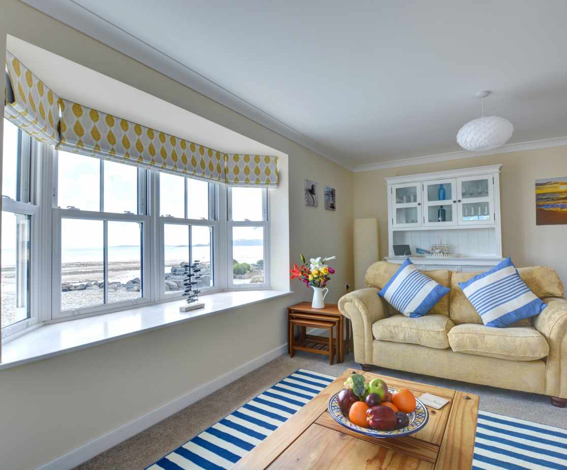 Spacious lounge with sea views