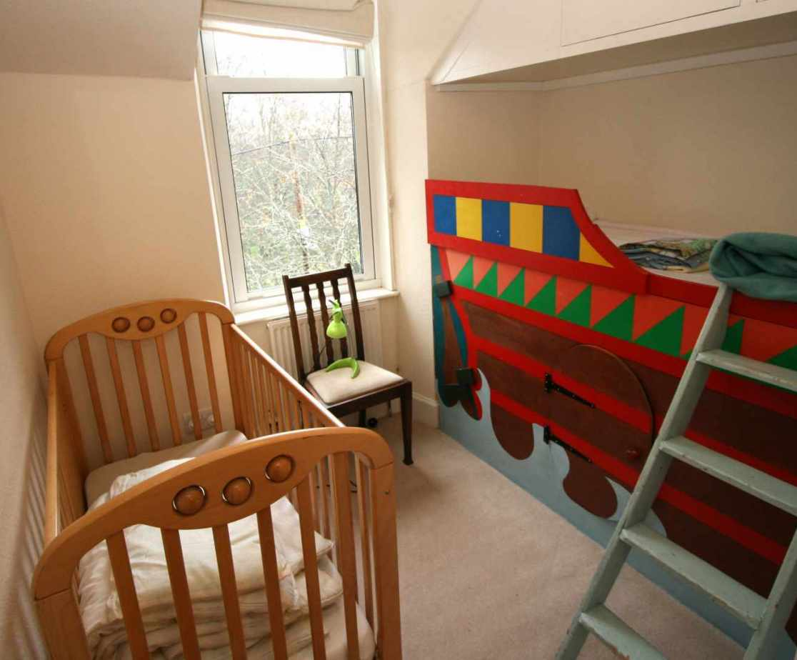 Room 5 is the nursery bedroom for a baby or small child