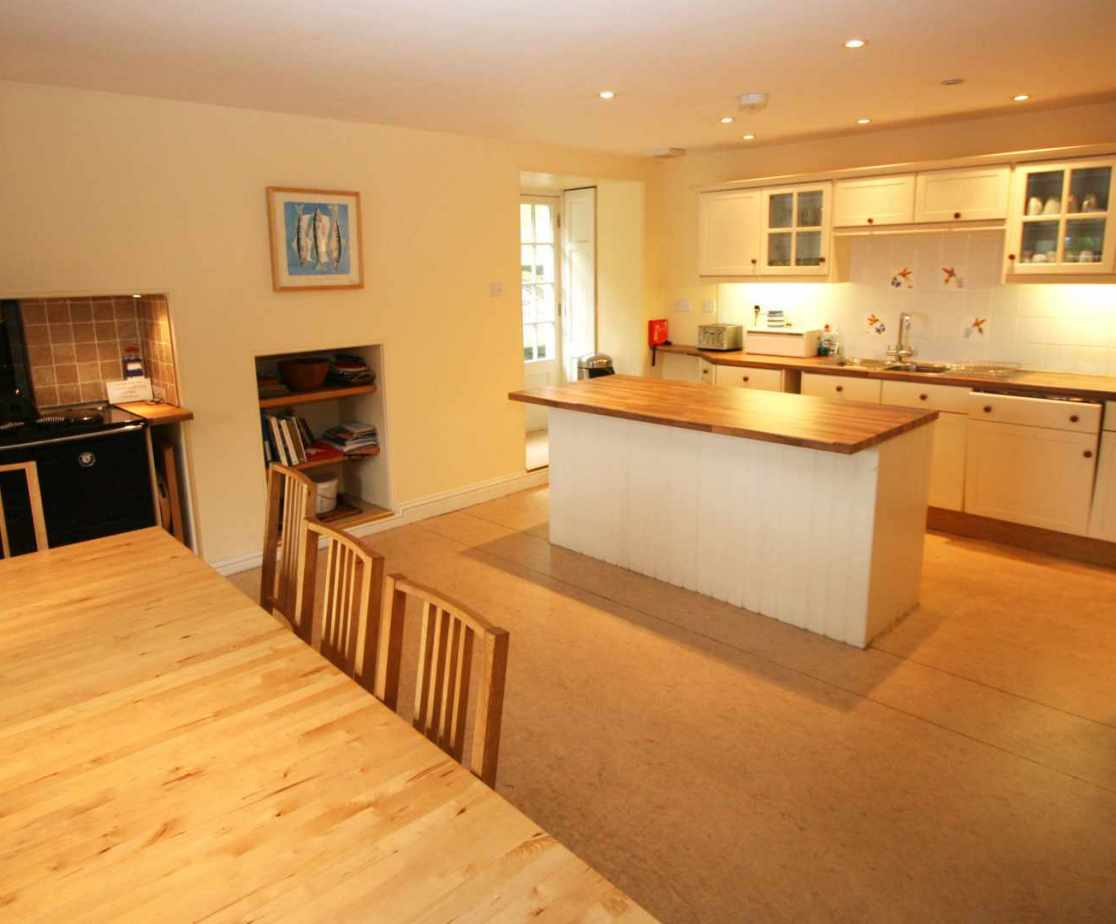 The kitchen has an oil fired range cooker, an electric hob and double oven