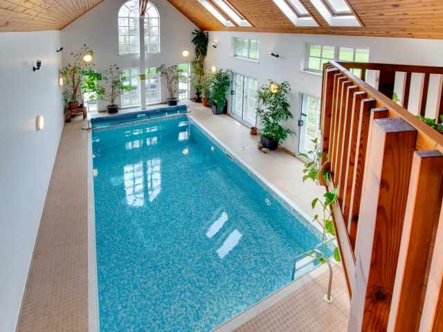 A super private indoor heated swimming pool with shower, toilet & sauna.