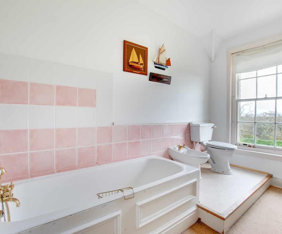 Spacious bathroom with garden views