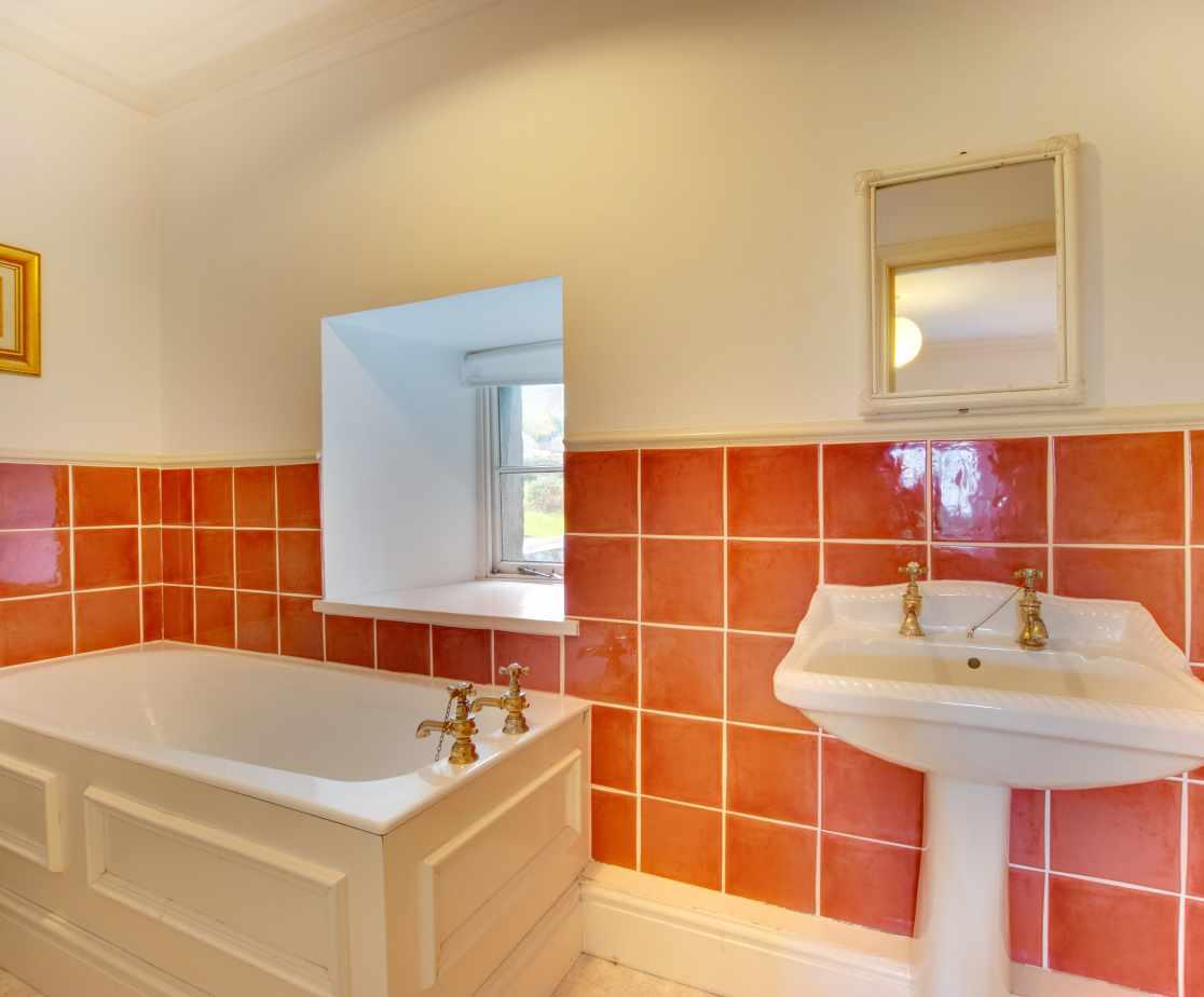 Bathroom with bath WC & WHB.