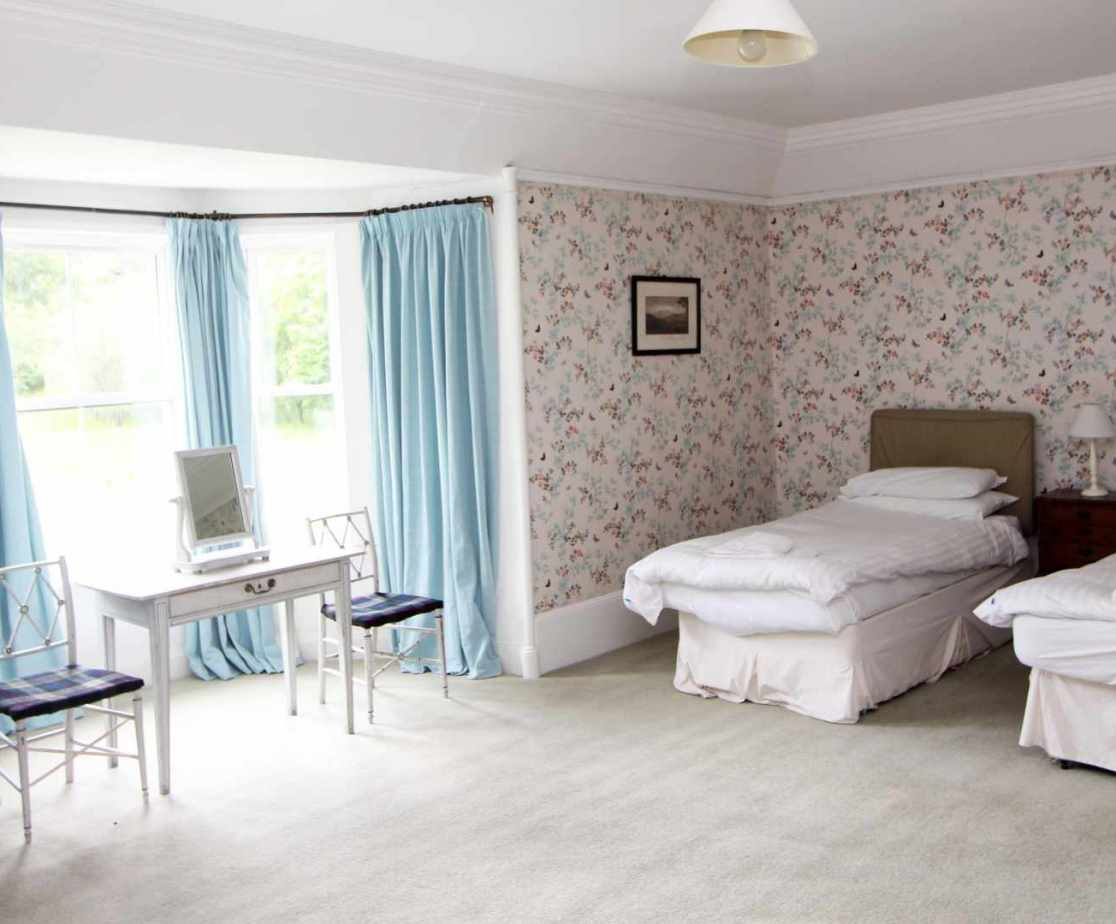 The Master bedroom on the first floor has twin beds and lovely views