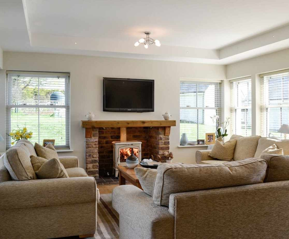 Sitting room with TV and wood burner