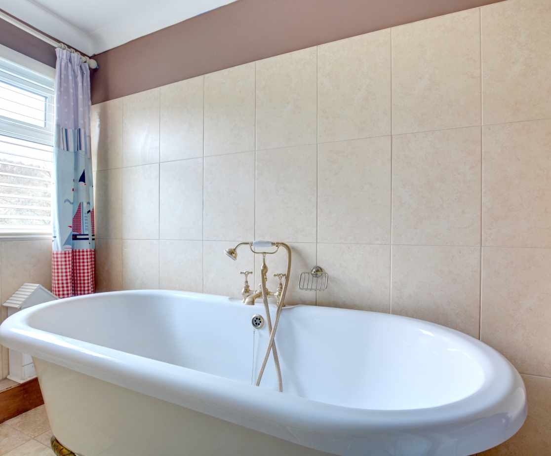 Bathroom with roll top bath, toilet and wash basin