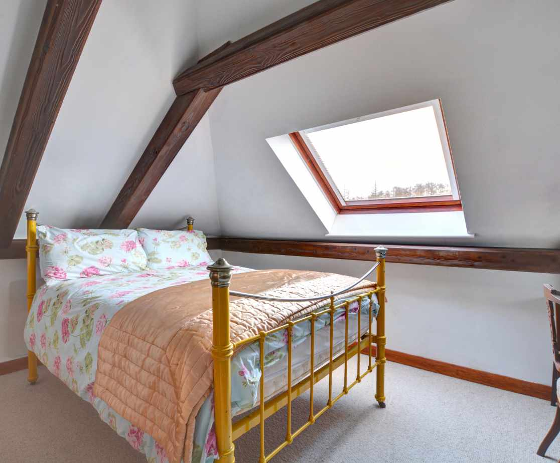 A double bedroom with beams