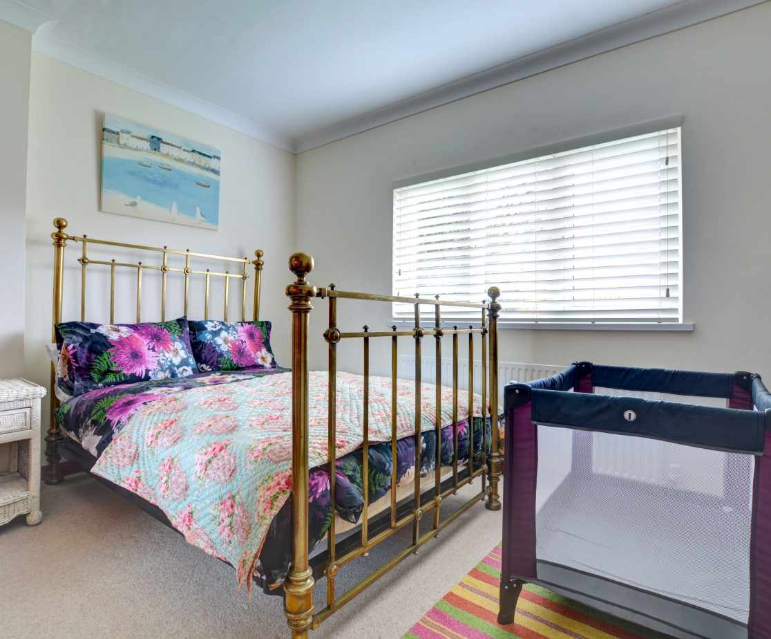 A second super king sized bed with travel cot