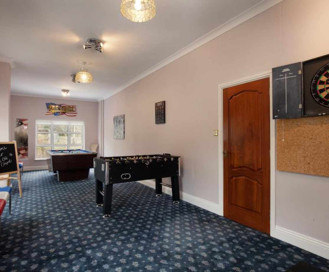 Fantastic games room with table football, darts & pool more.