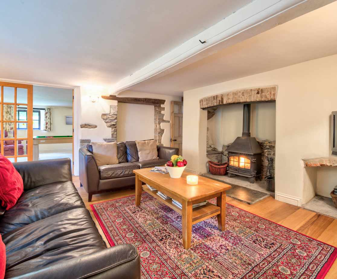The sitting room has a cosy feel with the log burner lit