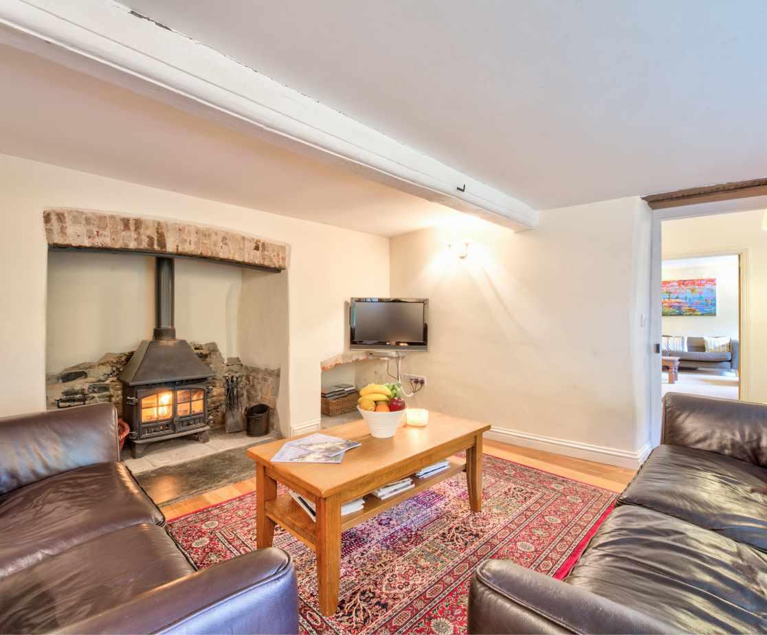 Cosy sitting room with log burner
