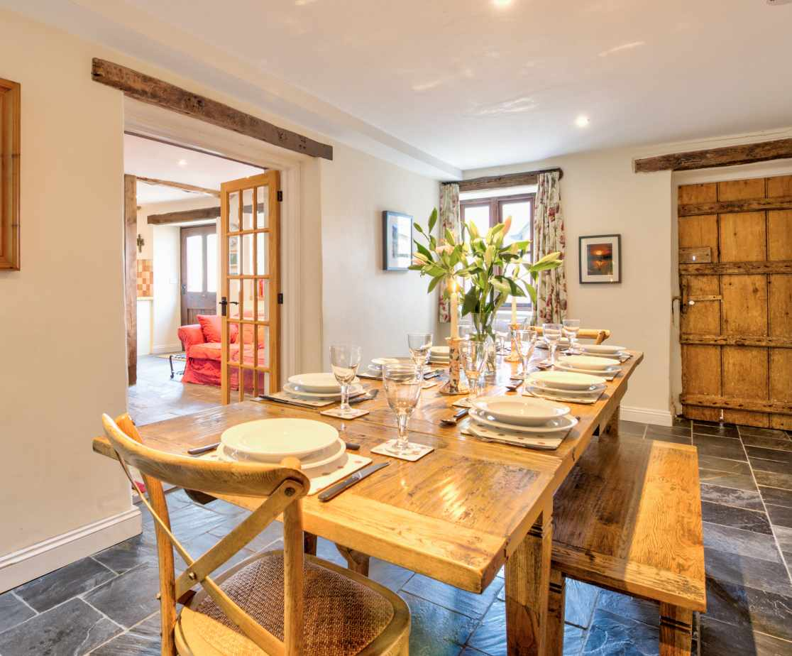 The beautiful rustic dining table comfortably seats 12 people