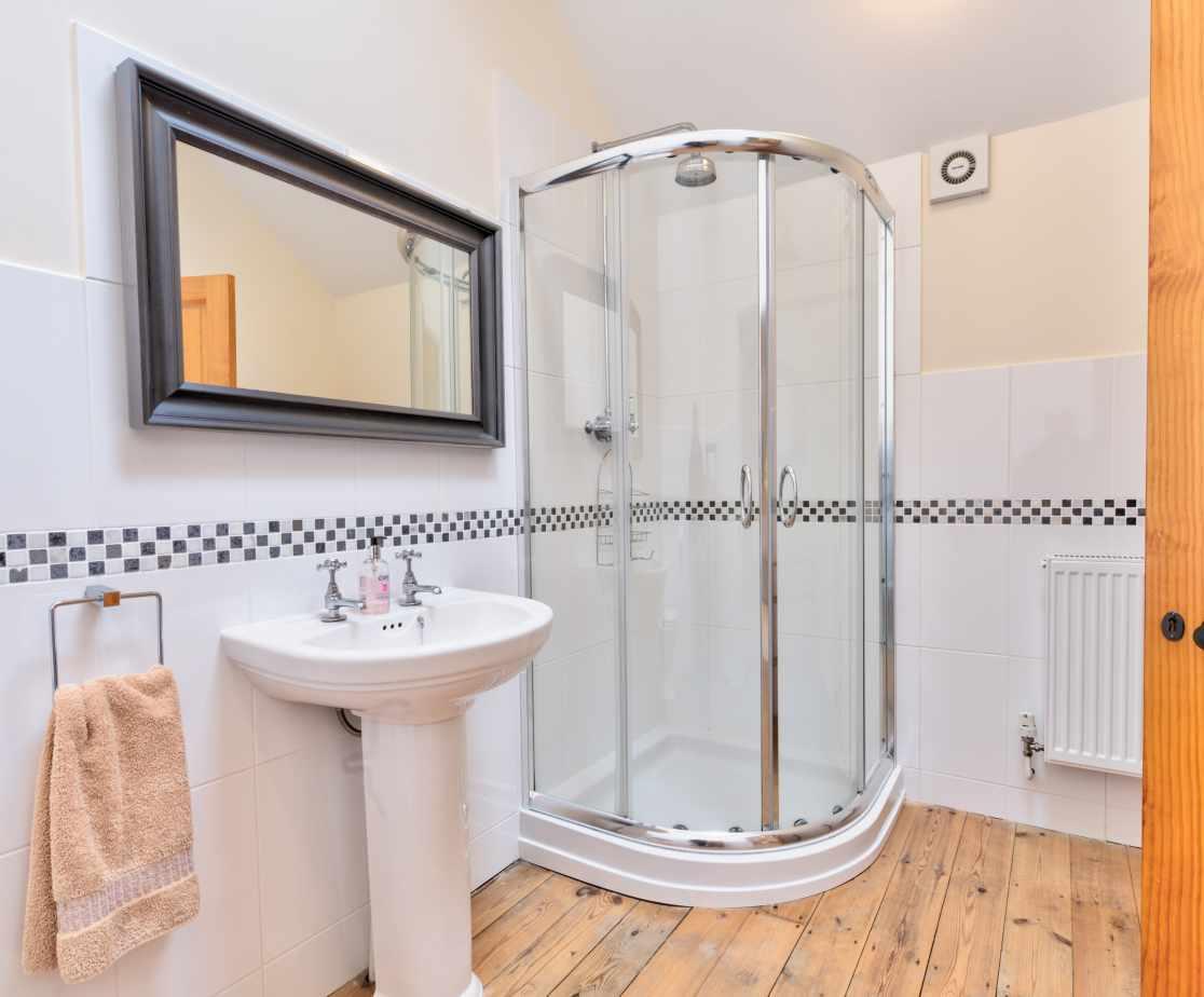 Master bedroom ensuite with corner shower