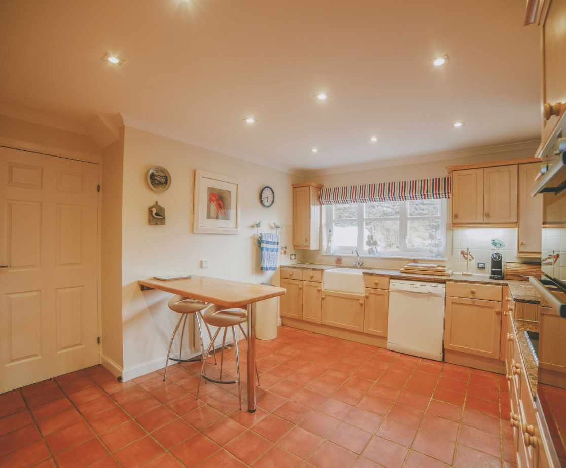 The kitchen opens off the dining room and is equipped with everything you might need to prepare meals with your group