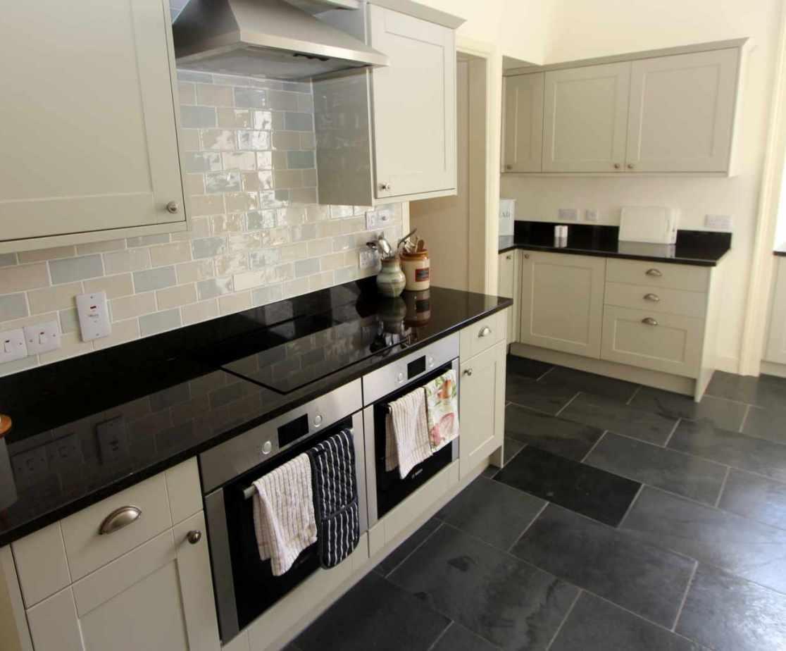 The compact practical kitchen is next door