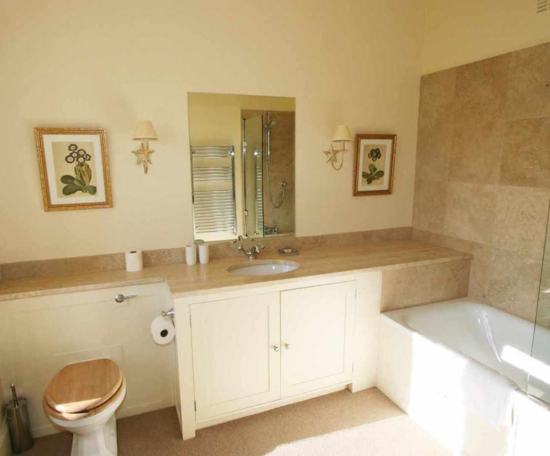 The bright modern en-suite bathroom for room 2