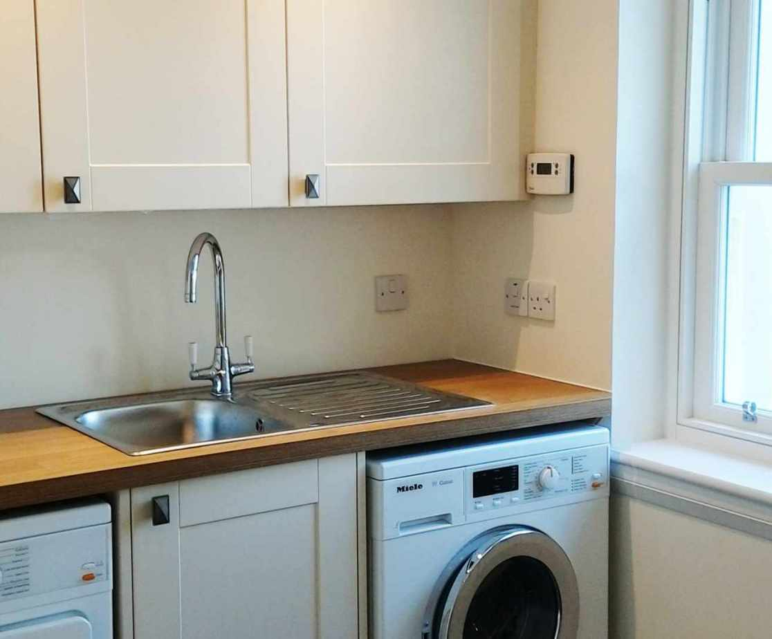 An additional utility room is at the rear of the house