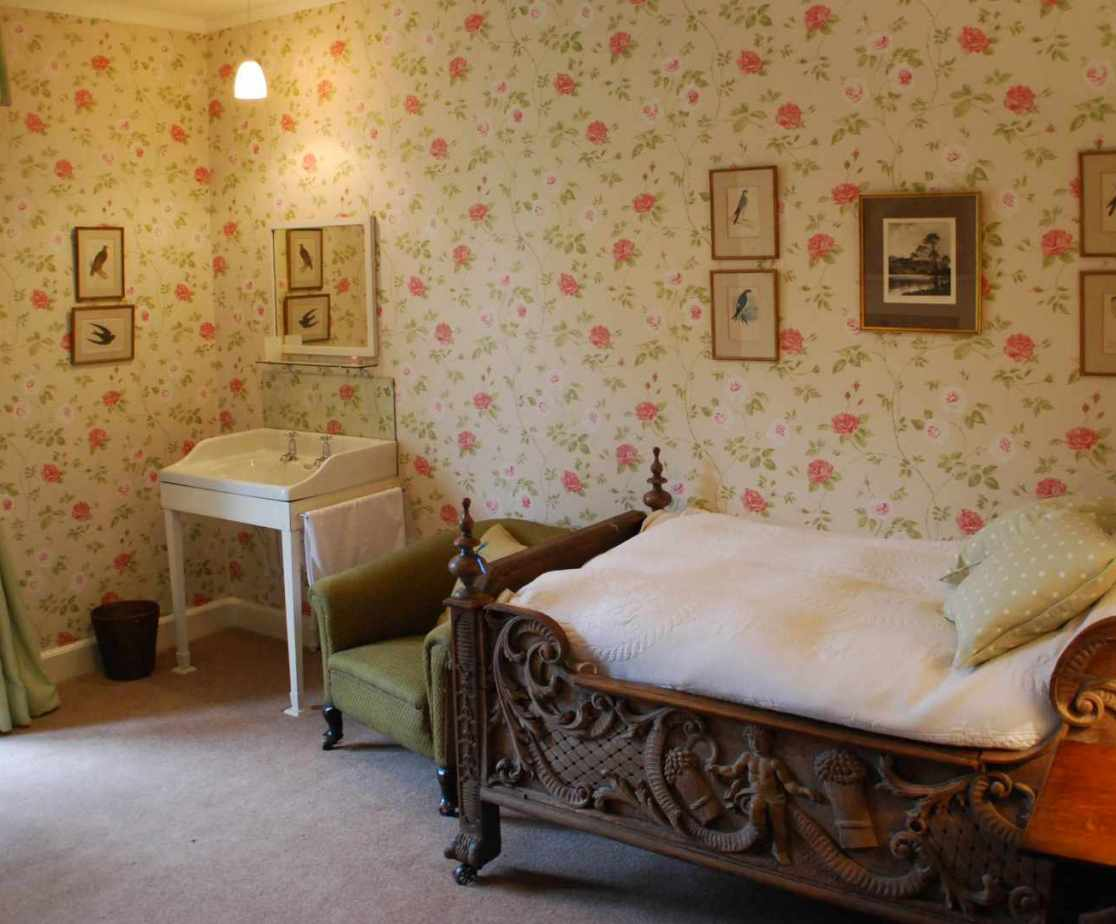 Room 7, is a single bedroom with an impressive wooden bed