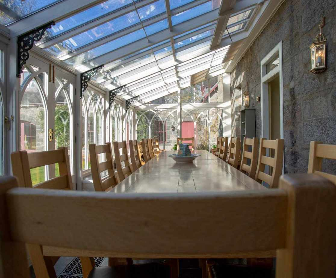 The conservatory dining room where most meals are served
