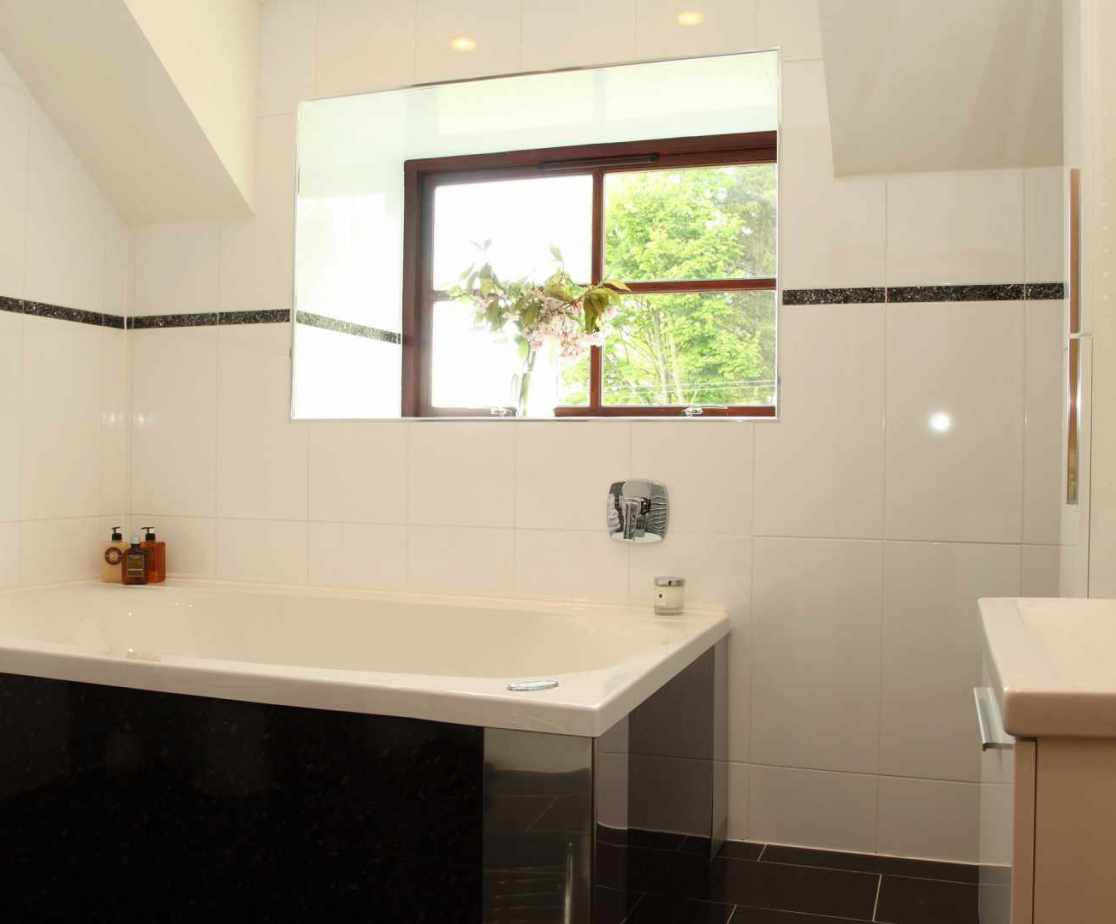 All the of the 5 bedrooms have en-suite shower rooms, with this being an additional bathroom