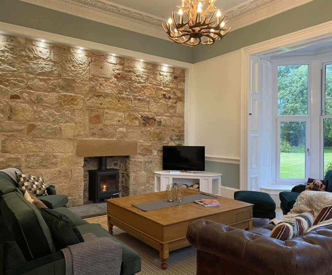 Sitting room with woodburner and flat screen TV