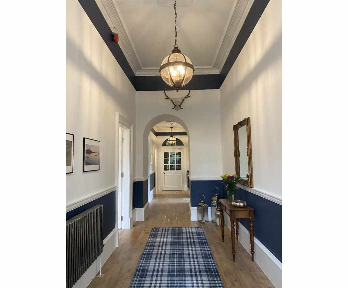 The spacious entrance hall is beautifully decorated