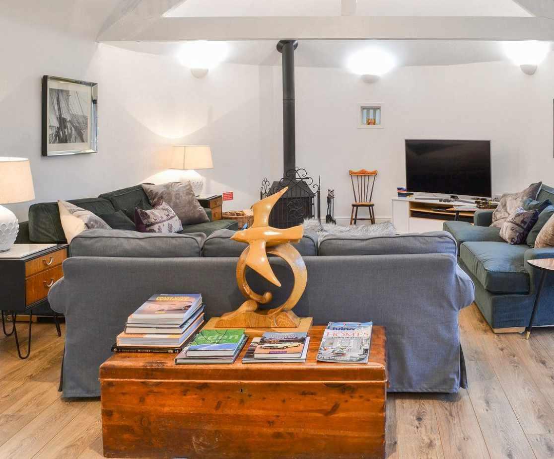 Wood-floored living room with wood burner