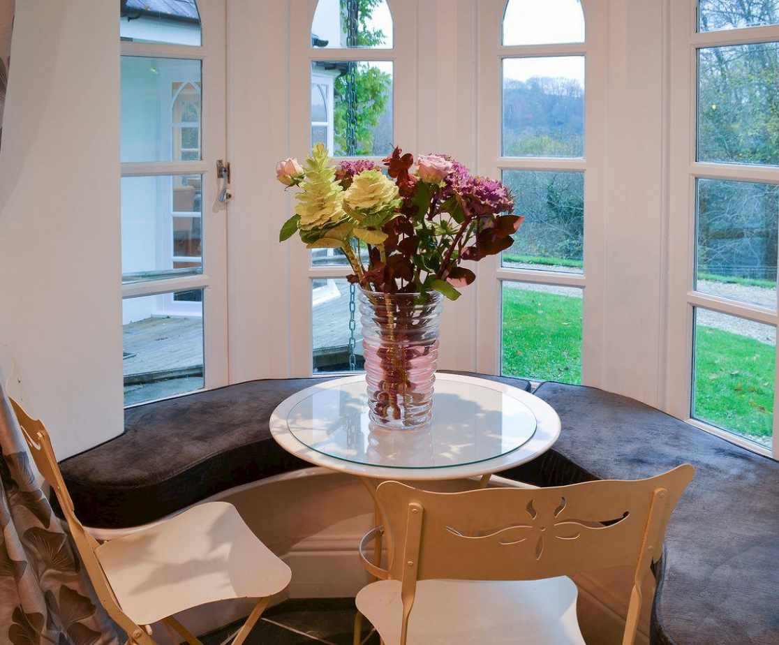 Lovely cosy window seat and table in the kitchen
