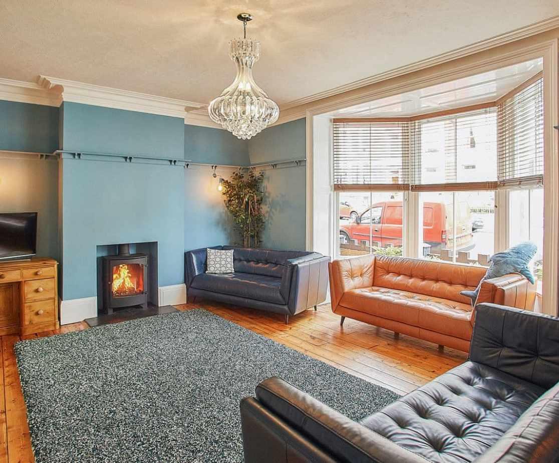 Stunning living room with wood burner