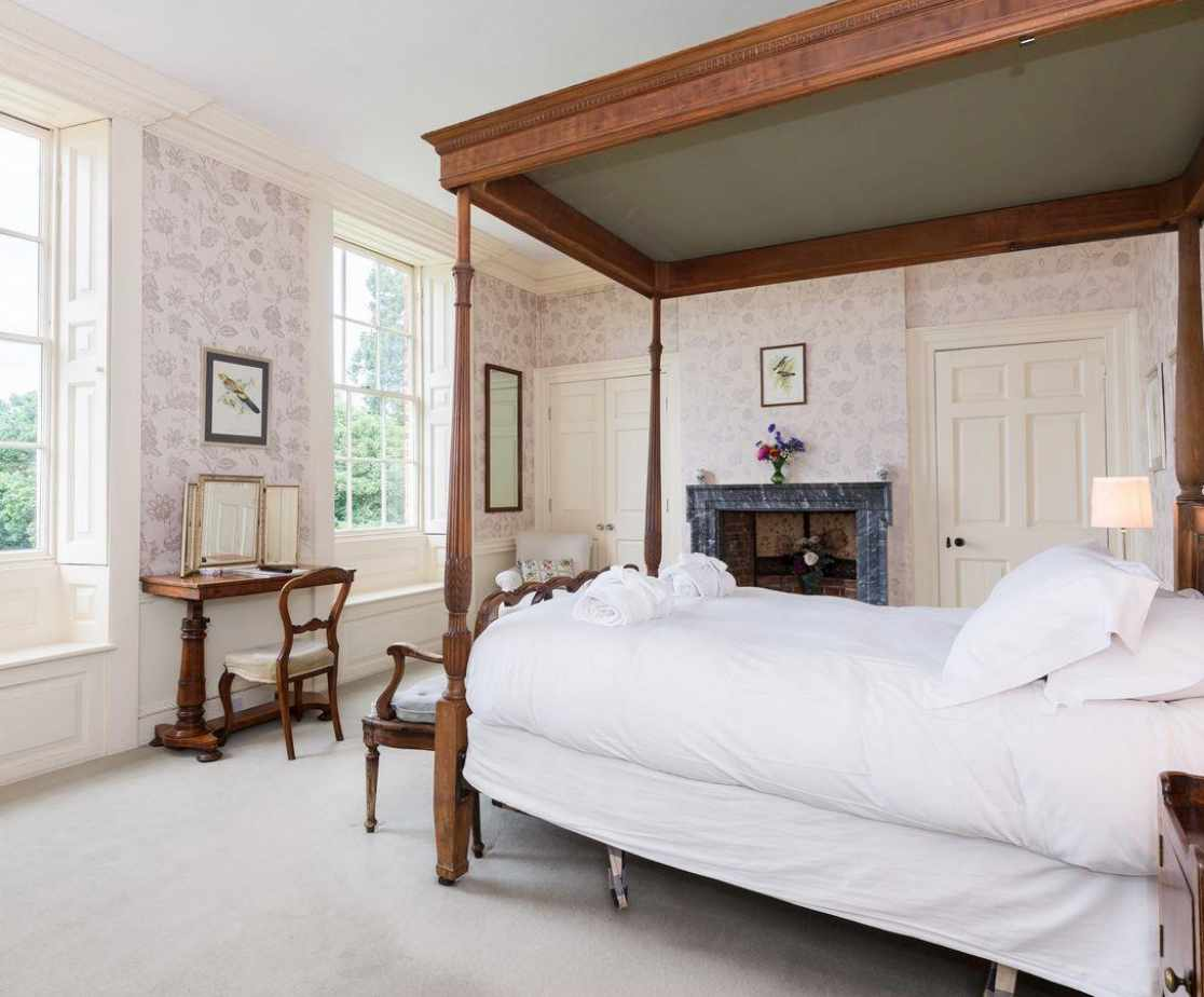 Comfortable four poster bedroom