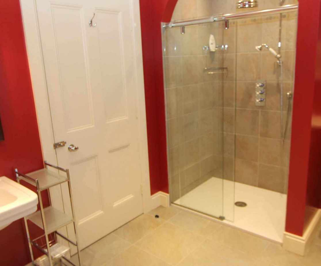 Ground floor en-suite with bath and shower cubicle