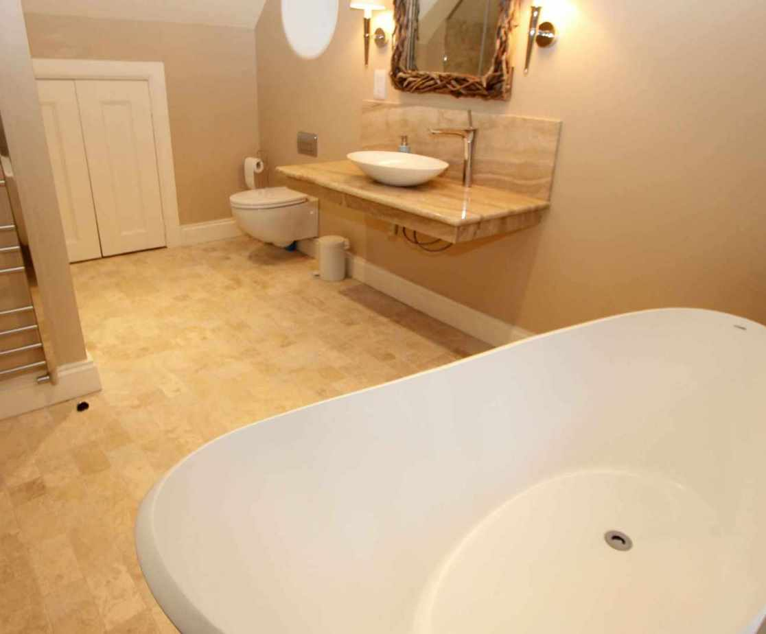 En-suite bathroom for bedroom 1, with feature bath tub