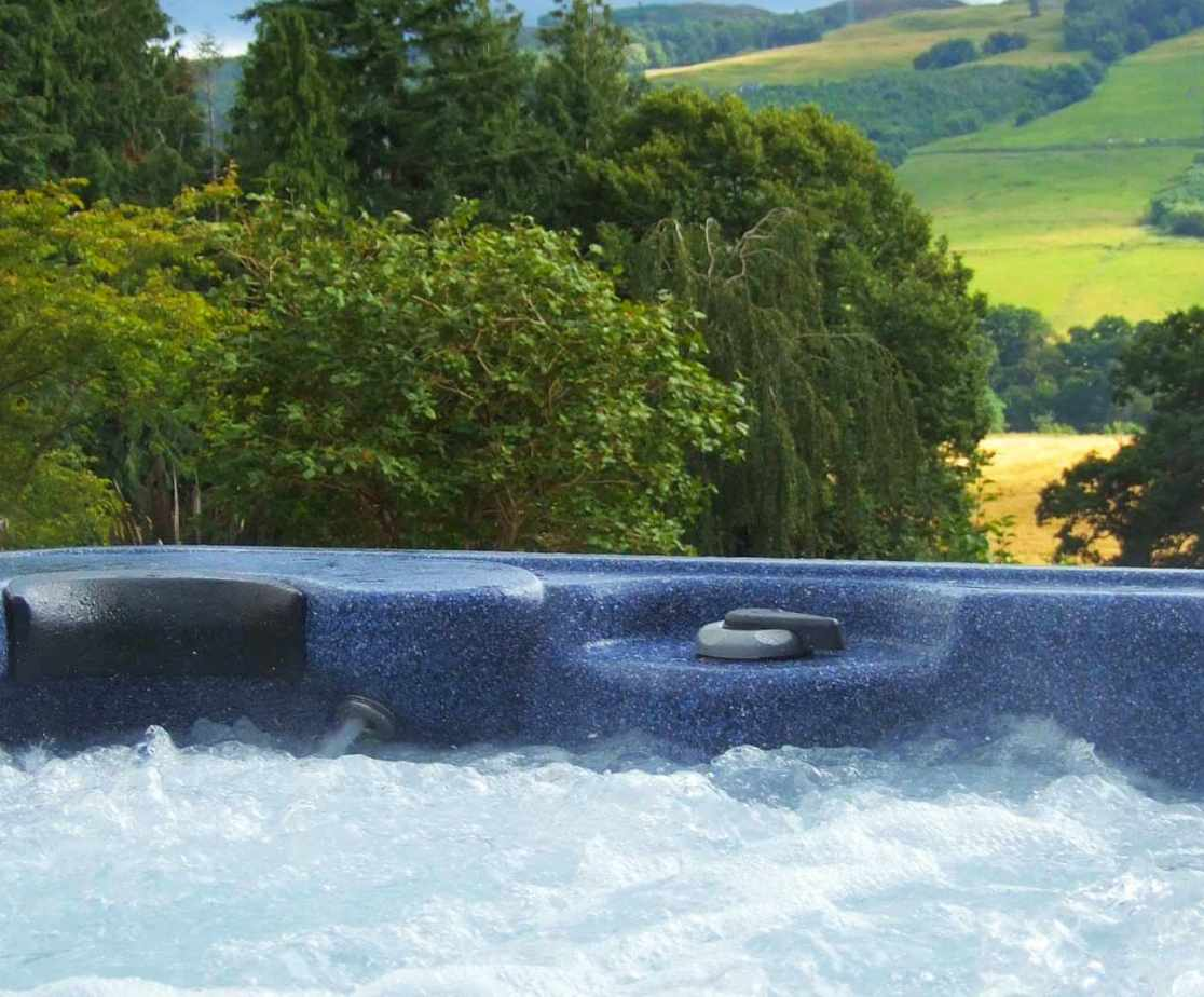 The hot tub looks over the stunning Scottish landscape