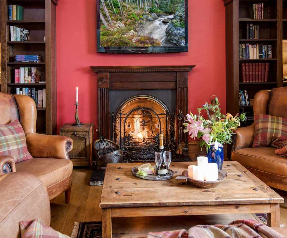 The \'library\' with the open fire is another cosy space