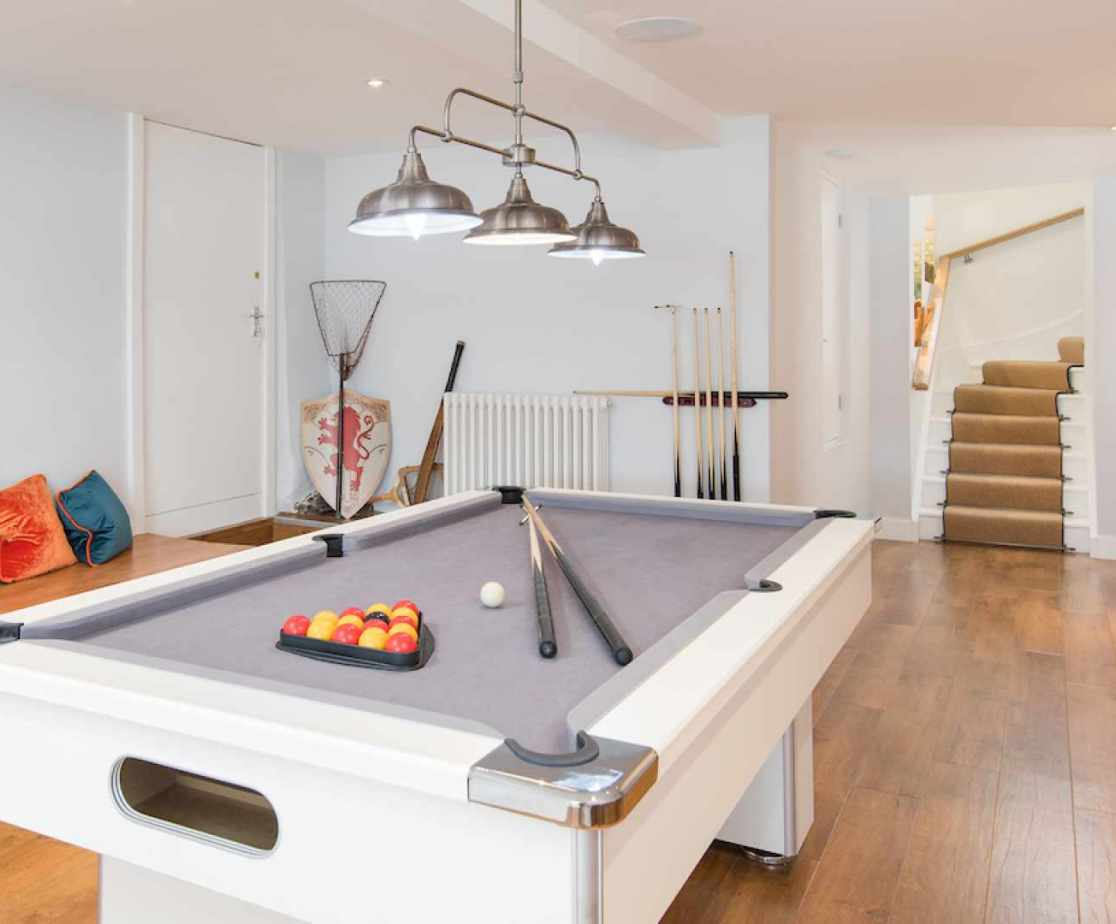 The games room with pool table is also found at this level