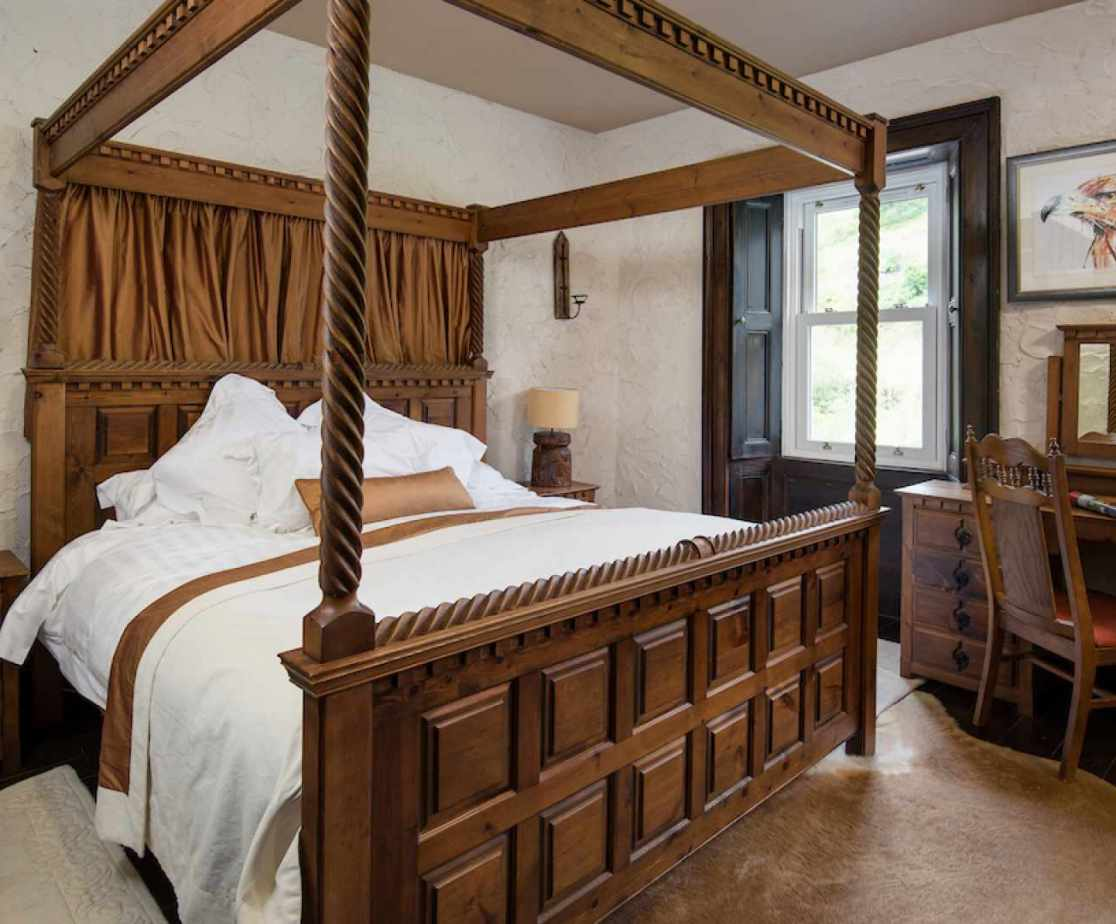 The \'Golden Eagle\' bedroom has a Four poster king size bed
