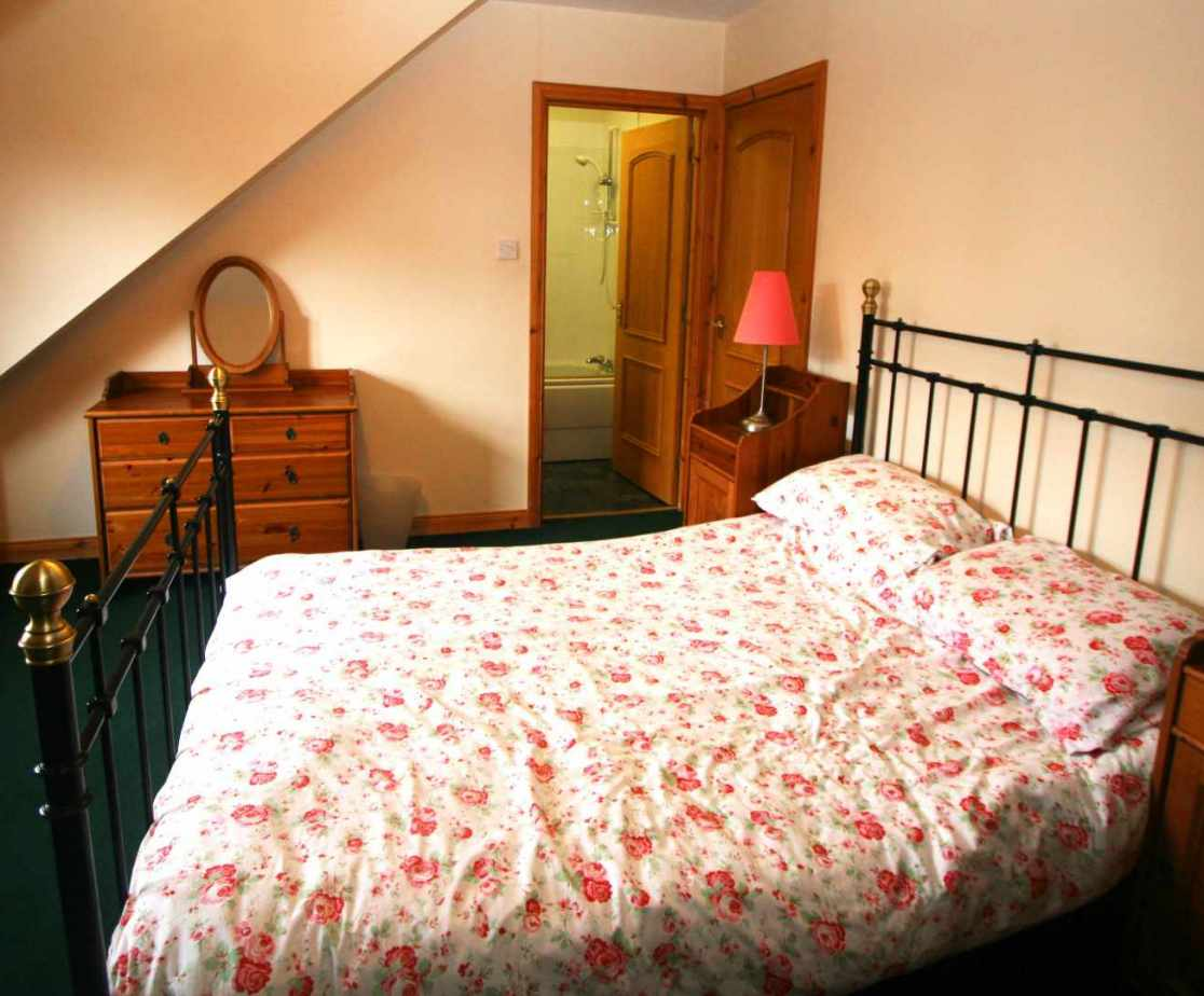 Room 1 is a double bedroom with en-suite bathroom on the first floor