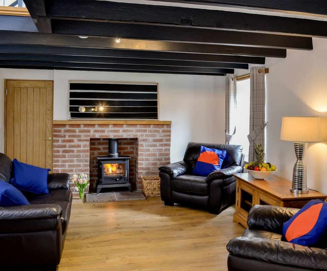 Comfortable second living room with wood burner