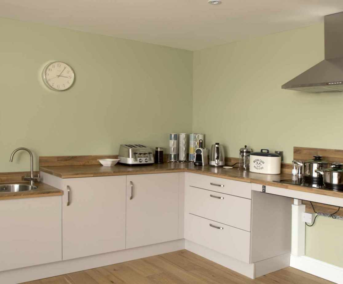 Luxury Perthshire Farmhouse, kitchen designed with two different levels for the sink and hob for wheelchair accessibility