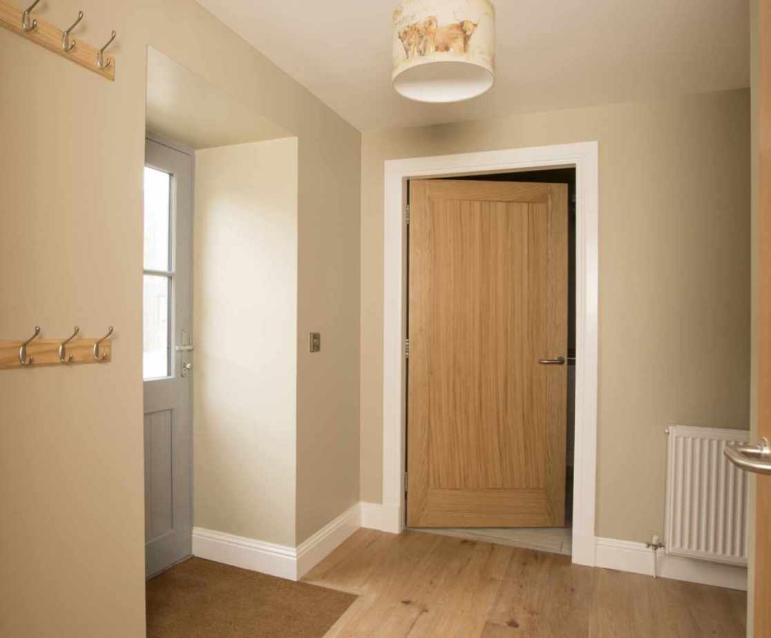 Luxury Perthshire Farmhouse, downstairs hall with coat hooks