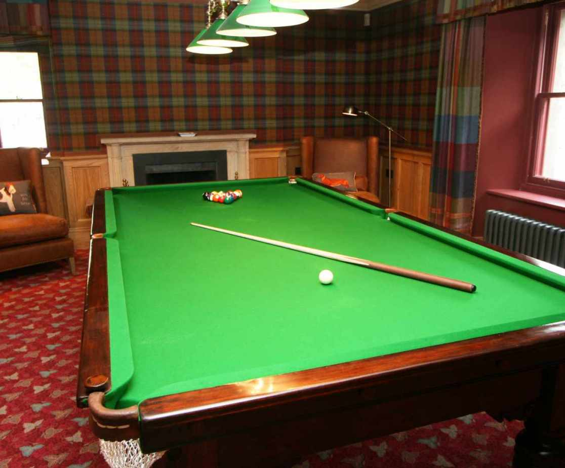 A 3/4 sized snooker table in the games room