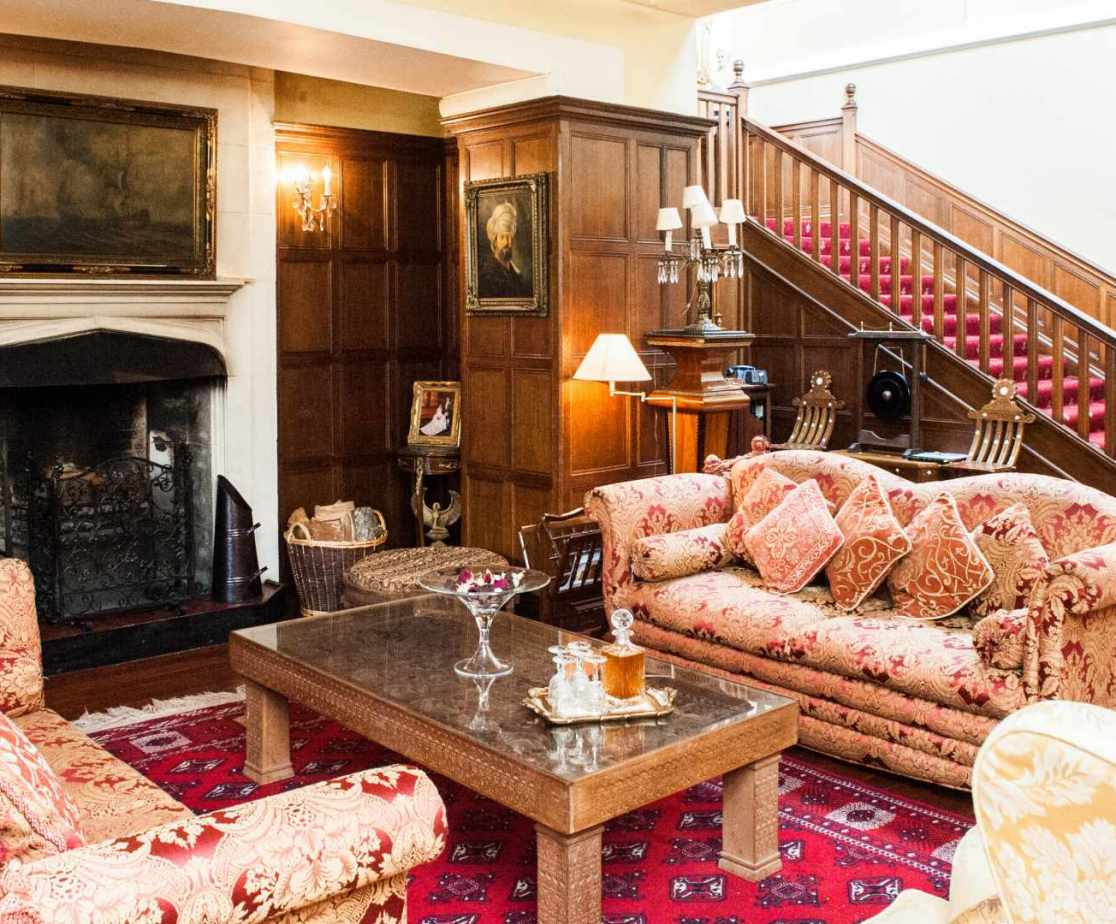 The great hall has a wood-burning stove and plenty of sofas