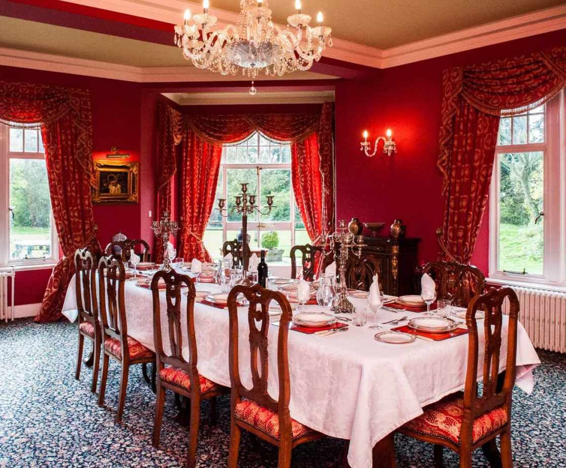 The dining room enjoys views across the lawn