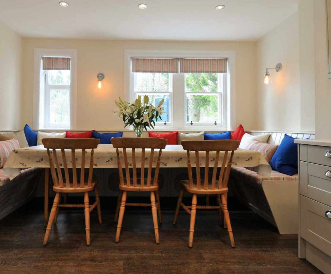 The kitchen comes with a large breakfast table seating 12